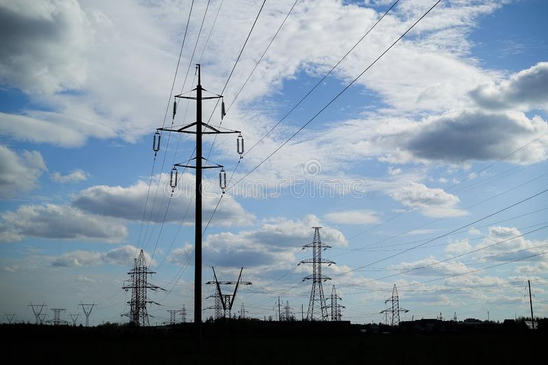 Panorama of high voltage substation. Distribution electrical power. Silhouettes of pylons and towers.  royalty free stock photos