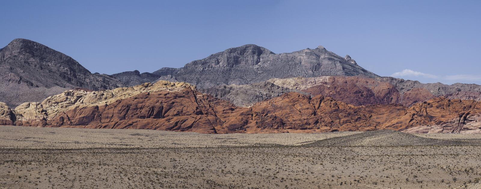 Panorama of hills in Red Rock Canyon, Nevada. Panoramic view of hills of the Red Rock Canyon Nevada, during a sunny day of summer royalty free stock photo