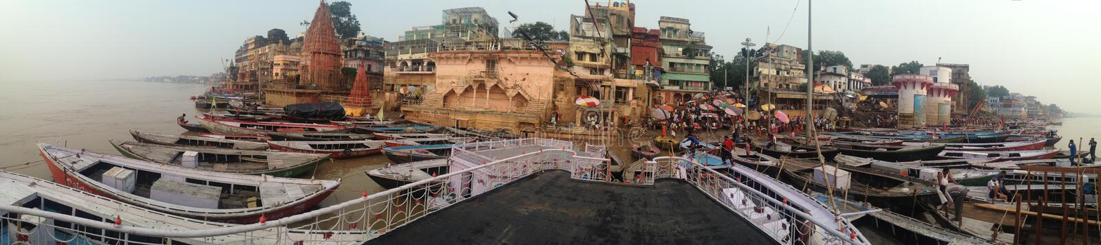 Panorama of holy Varanasi with pilgrims taking their bath in the Ganges and locals waiting for tourists in September 2016 royalty free stock photography