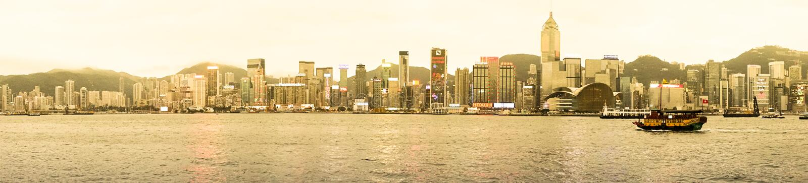 Panorama of Hong Kong. A beautiful landscape of Hong Kong with chinese old sailtboat which made a strong comparison. Date: 18 Mar 2014 Location: Tsim Sha Tsui ( royalty free stock photo