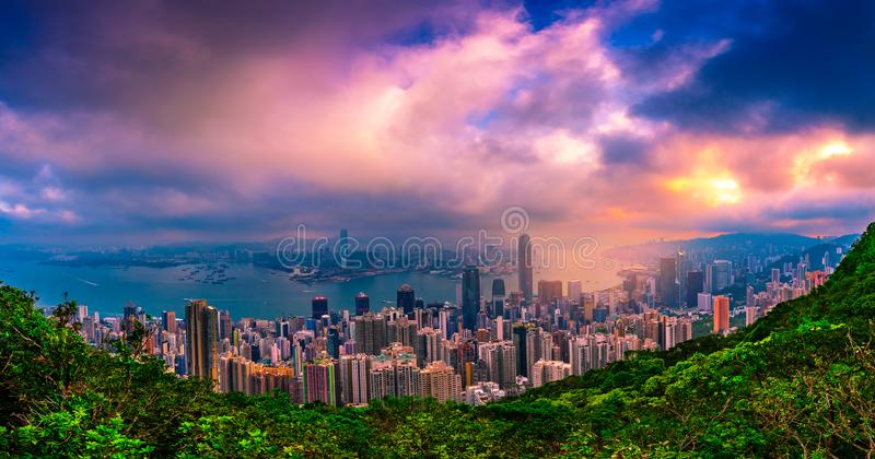 Panorama Hong Kong City skyline at sunrise. Hongkong skyscraper view from The peak.  stock photo