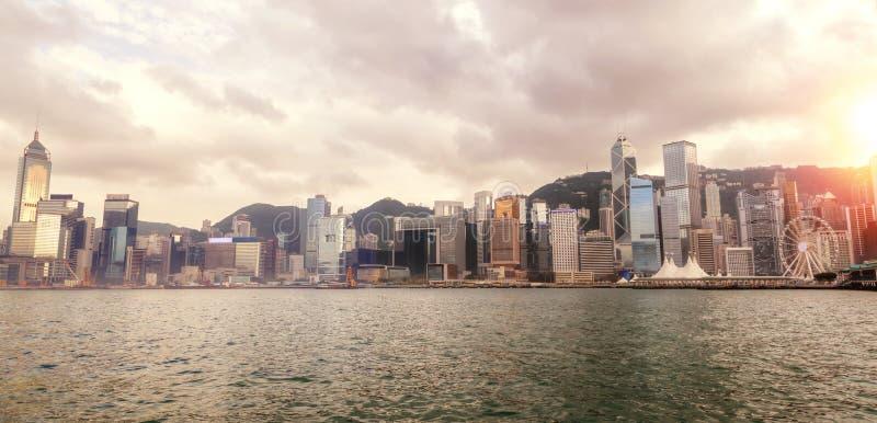 Panorama of Hong Kong Sunset Skyline at Victoria Harbor. Wide-angle panorama of Hong Kong`s Central District skyline on Victoria Harbor at sunset. Viewed from stock photos