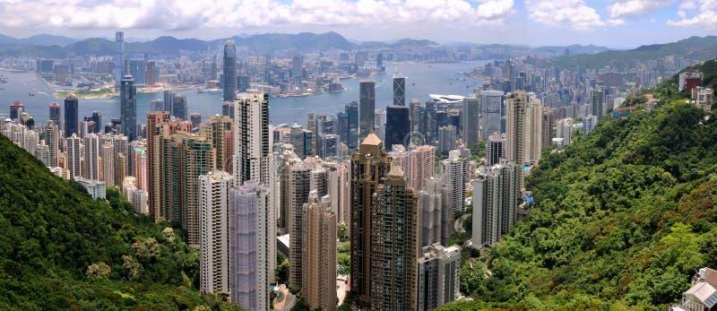 Panorama of Hongkong Victoria harbor and city. Panorama view of Hongkong urban and Victoria harbor from Taiping peak, on May 9, 2012. Hongkong is a developing stock image