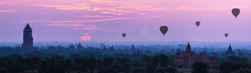 Panorama Hot air ballons over pagodas in sunrise at Bagan, Myanmar. royalty free stock photography