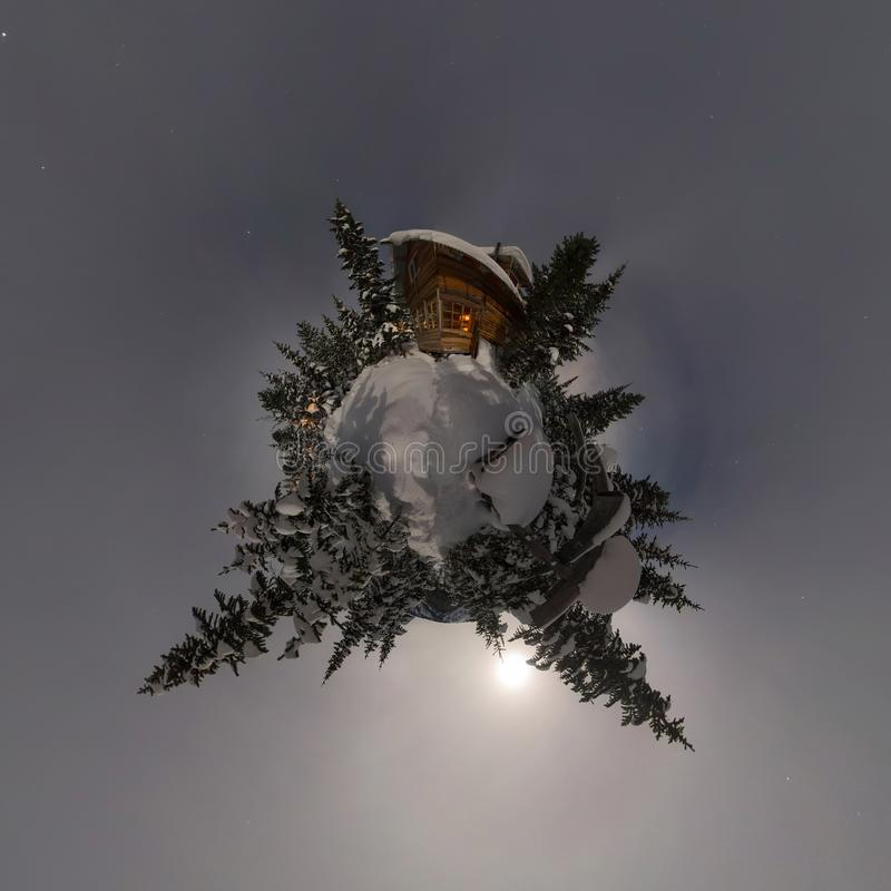 Panorama house chalet during a snowfall in the trees winter forest at night in the moonlight. Tiny planet 360 panorama stock images