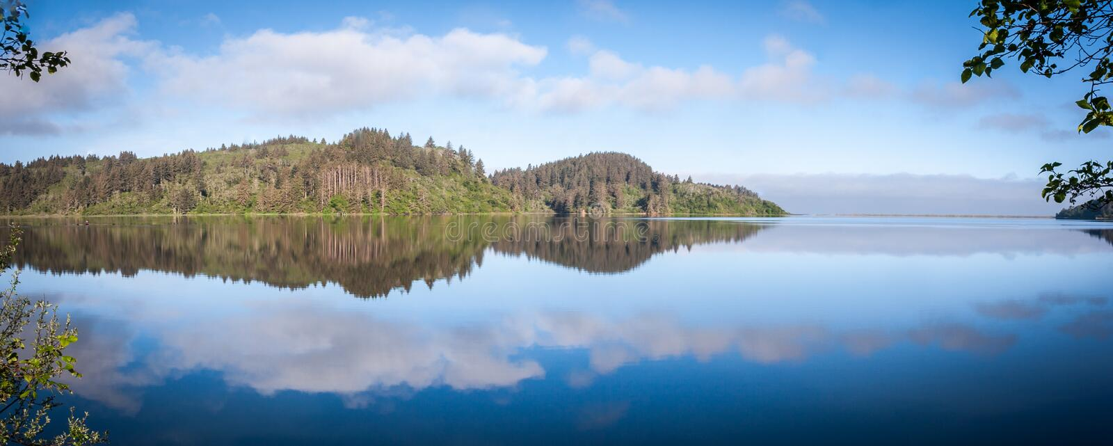 Panorama of the Humboldt Lagoons in Early Morning. A calm lagoon in the Humboldt National Lagoons State Park in California on an early morning, reflected in the stock photography