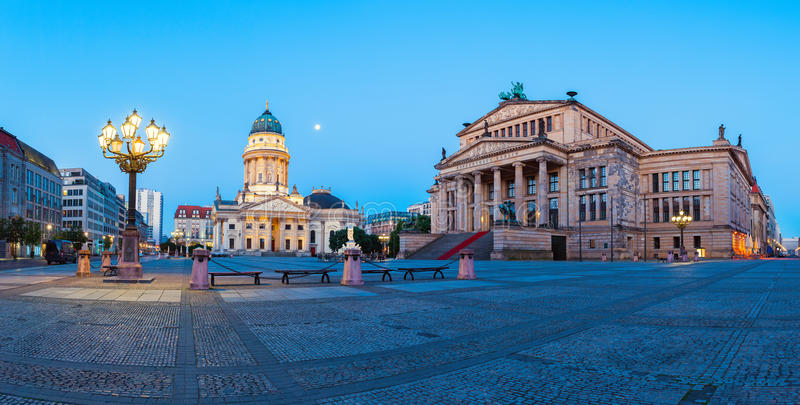Panorama image of Gendarmenmarkt square in Berlin. With German church and Concert Hall at dawn stock photography