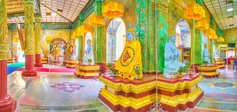 Panorama of image house of Kyauktawgyi Buddha Temple, Mandalay,. MANDALAY, MYANMAR - FEBRUARY 23, 2018: Panorama of Kyauktawgyi Buddha Temple image house with royalty free stock image