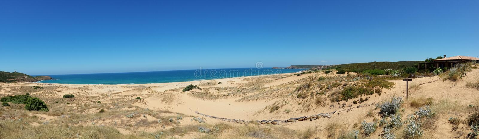 Panorama image of sand dunes and sea on the island of sardinia italy stock photography