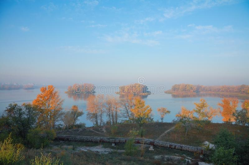 Panorama, islands on the river, in the morning. Panorama, islands on the Dnieper River, pipeline, autumn landscape in the morning stock image