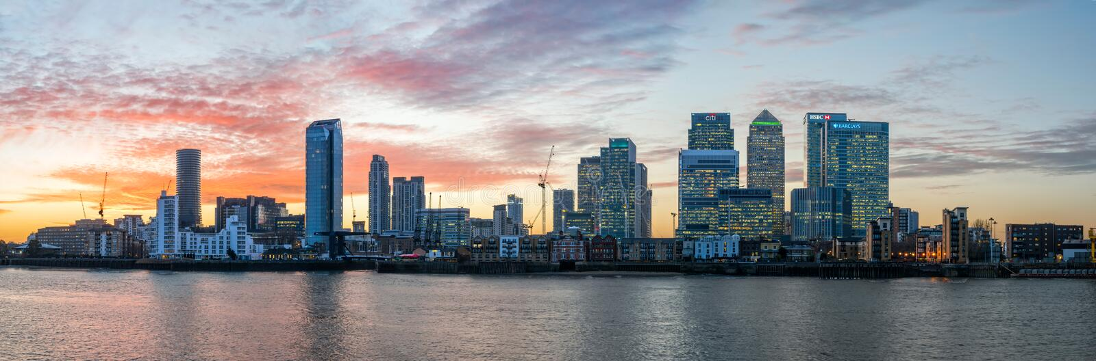 Panorama of Isle of Dogs and Canary Wharf in London at sunset stock photo