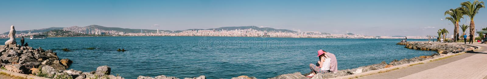 Panorama of Istanbul Embankment, Istanbul, Turkey. A large panorama of the Istanbul Embankment on a summer sunny day with a pair of tourists in love with royalty free stock photos