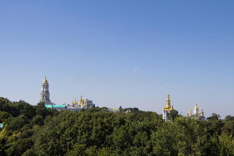 Panorama of Kiev Hills with a skyline made of the domes of Pechersk Lavra Monastery and churches, surrounded by a wood. Picture of the Kiev Monastery of Pechersk royalty free stock images