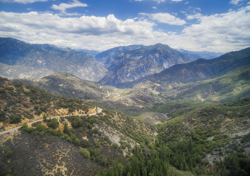 Panorama of Kings Canyon National park area, USA. Panoramic view of Kings Canyon National park area in sunny summer day. Kings Canyon National Park is a national royalty free stock image