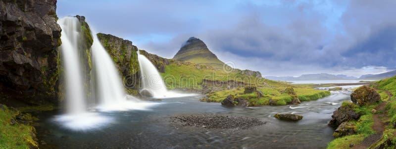 Panorama of Kirkjufell and Kirkjufellsfoss. In western Iceland royalty free stock photography