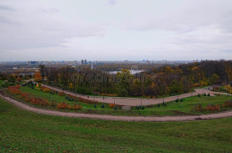 Panorama of Kyiv from the Park of Fame Park of Glory. Metro bridge across the Dnipro river. Cloudy autumn day. royalty free stock image