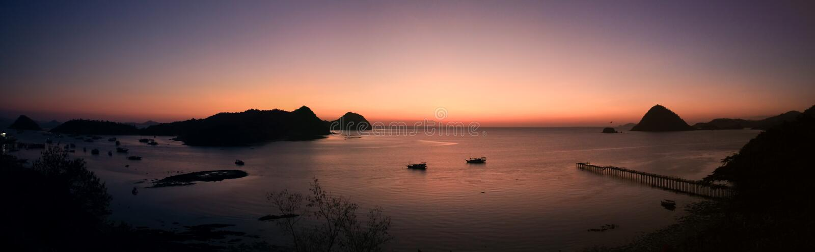 Panorama on Labuan Bajo bay at dusk, Nusa Tenggara, flores island, Indonesia. Labuan Bajo is a fishing town located at the western end of Flores in the Nusa stock photography