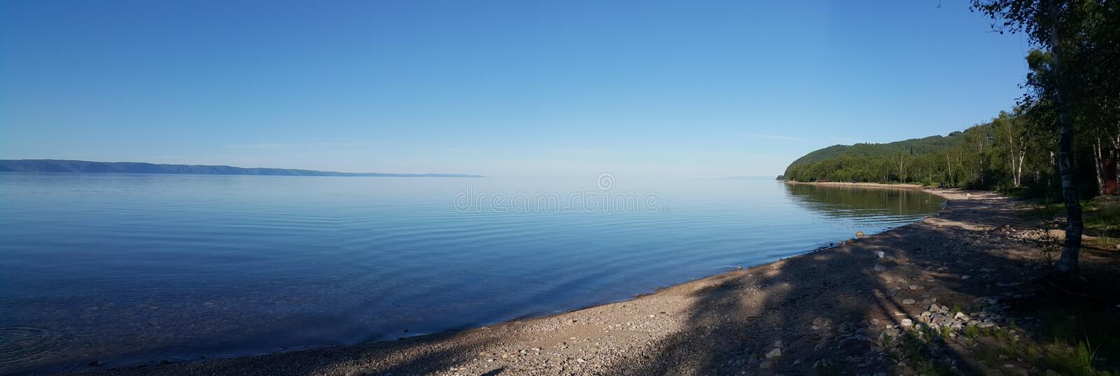 Panorama of lake Baikal. Is the most beautiful and deepest lake on our planet. The photo was taken in the Irkutsk region Slyudyanka in Russia stock photo