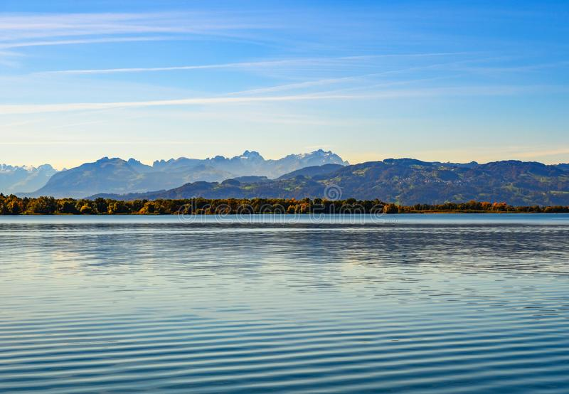 Panorama of lake Constance and alpine peaks on autumn royalty free stock images