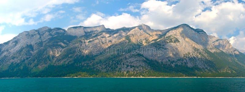 Panorama of Lake Minnewanka. Mountains at the edge of Lake Minnewanka, Banff national Park stock photo