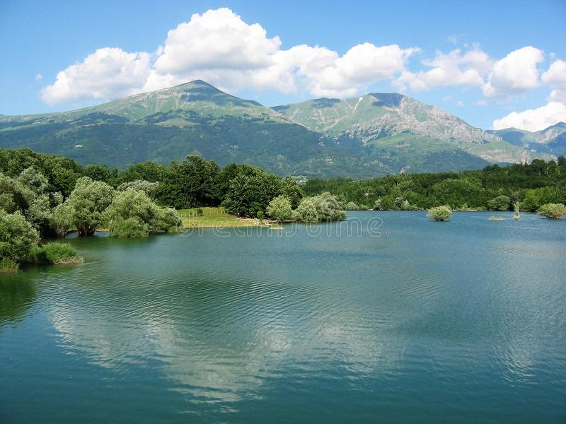 Panorama of the lake of Scandarello near Amatrice in Italy with reflections in the water. royalty free stock photo