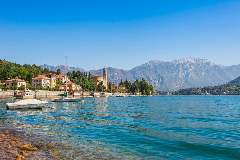 Panorama landscape on beatiful Lake Como in Tremezzina, Lombardy, Italy. Scenic small town with traditional houses and clear blue royalty free stock photography