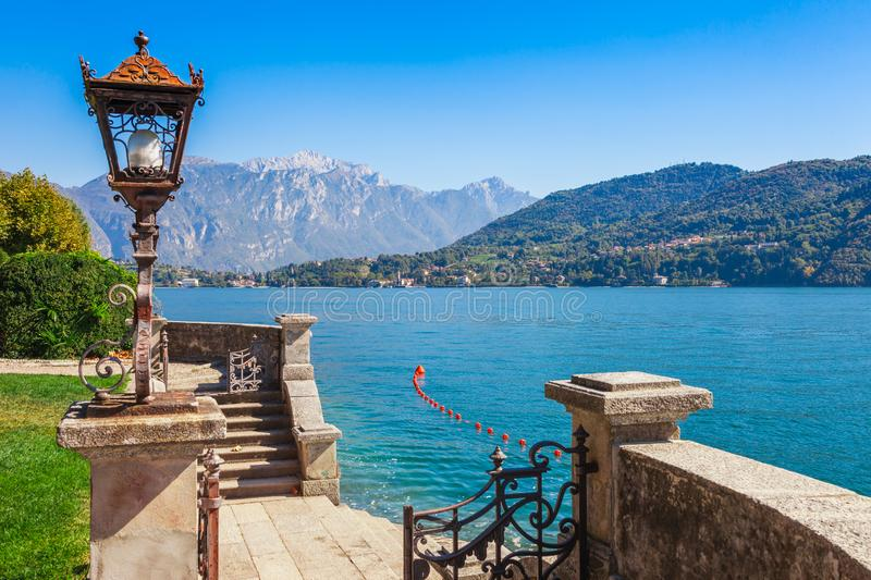 Panorama landscape on beatiful Lake Como in Tremezzina, Lombardy, Italy. Scenic small town with traditional houses and clear blue stock image
