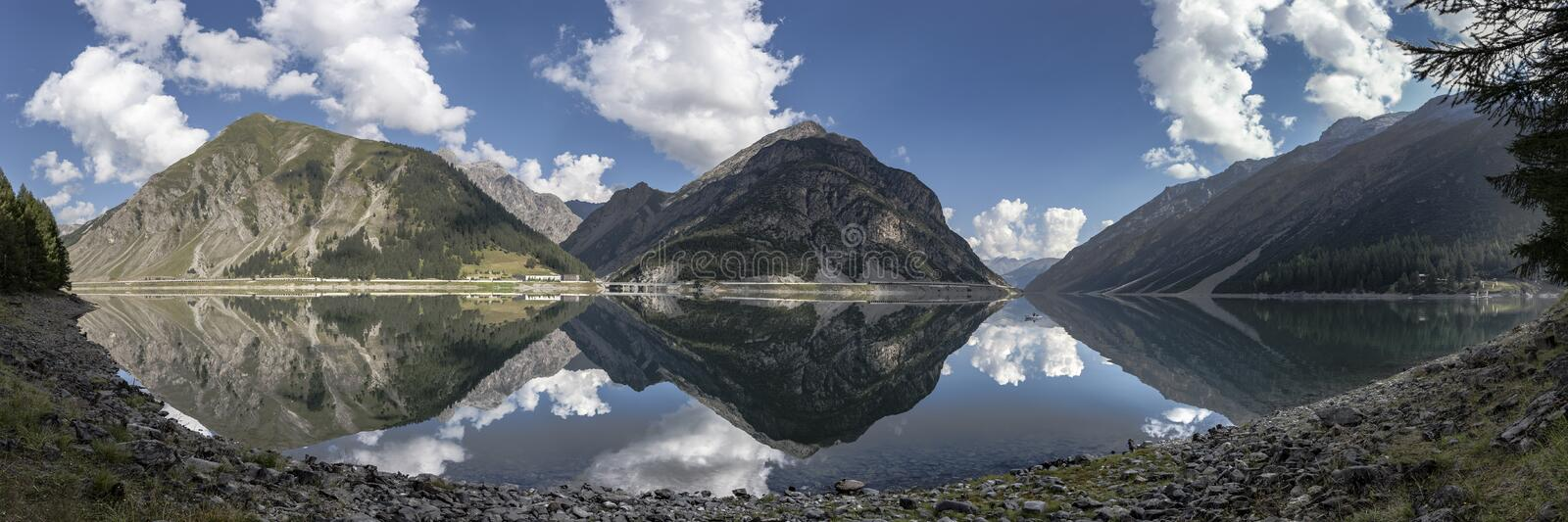 Panorama Landscape with Mountain Lake and a Boat stock photography