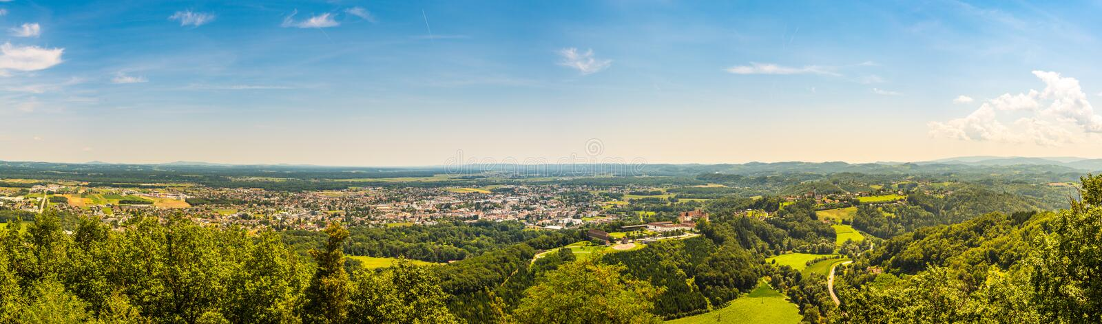 Panorama of Leibnitz in south styria in Austria. Landscape of Leibnitz area from Kogelberg. Tourist destination, Green hills of grape crops and mountains stock photos