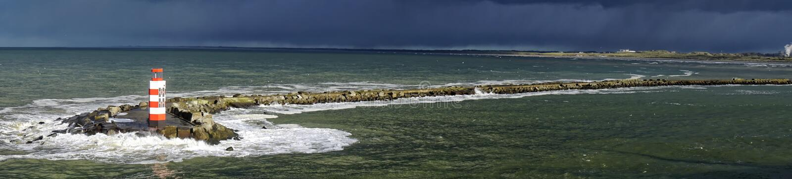 Panorama of Lighthouse in Stormy Sea royalty free stock photos