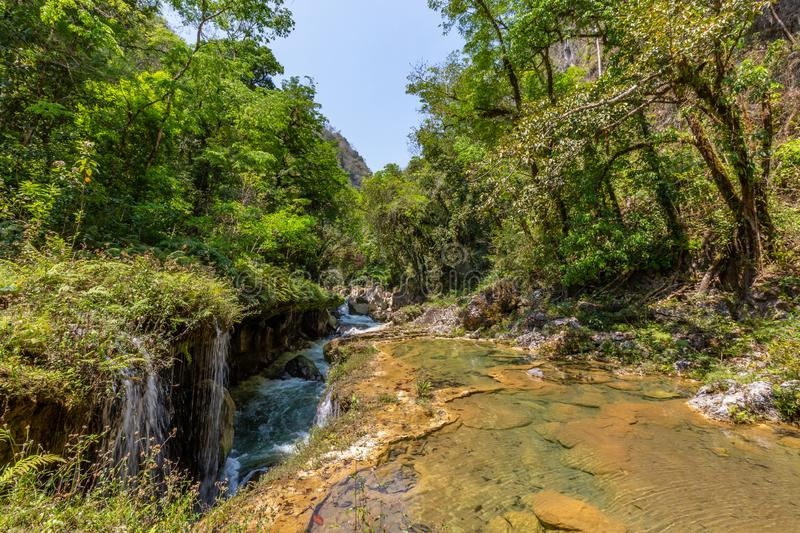 Panorama of the limestone ridge with cascades and waterfalls of Semuc Champey in the Peten jungle and rainforest of Guatemala royalty free stock photos
