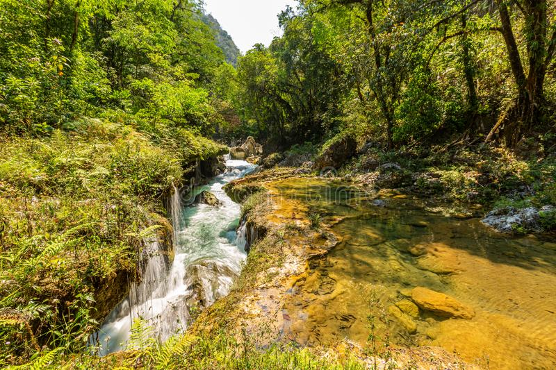 Panorama of the limestone ridge with cascades and waterfalls of Semuc Champey in the Peten jungle and rainforest of Guatemala royalty free stock images