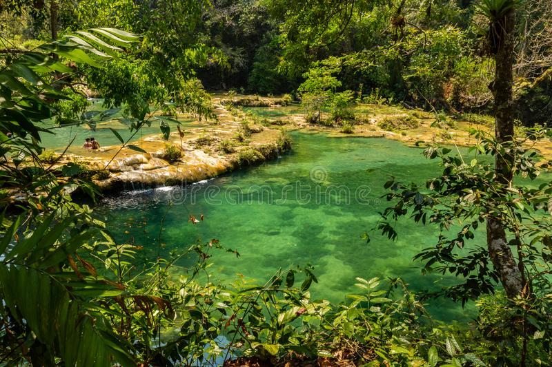 Panorama of the limestone ridge with cascades and waterfalls of Semuc Champey in the Peten jungle and rainforest of Guatemala royalty free stock photography