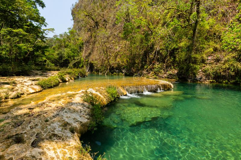 Panorama of the limestone ridge with cascades and waterfalls of Semuc Champey in the Peten jungle and rainforest of Guatemala stock photography
