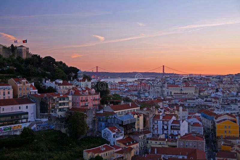 Panorama of Lisbon with the 25th of April bridge at dusk stock photo