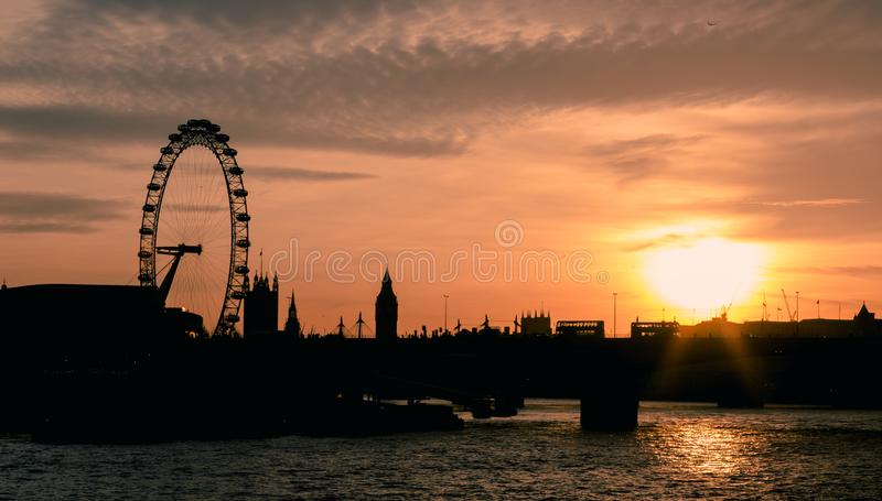 Panorama of London in sunset light. London Eye, Waterloo Bridge, Big Ben, House of Parliament royalty free stock photos