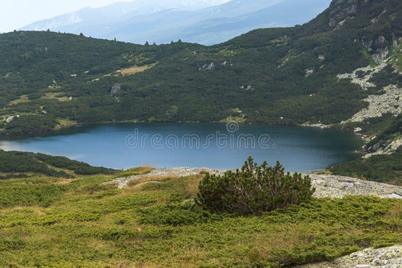 Panorama of The Lower Lake, Rila Mountain, The Seven Rila Lakes, Bulgaria. Amazing panorama of The Lower Lake, Rila Mountain, The Seven Rila Lakes, Bulgaria stock photo
