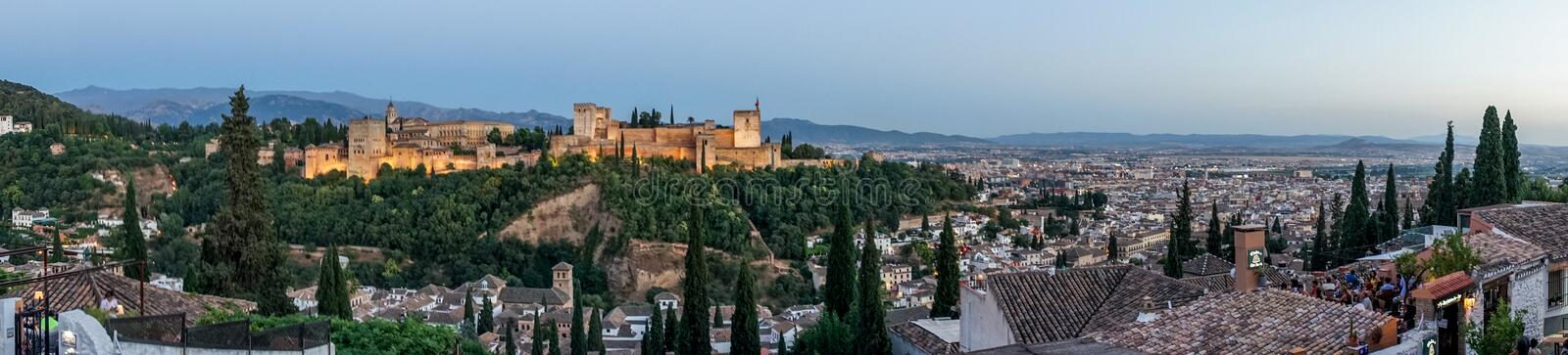 Panorama of the magnificient Alhambra of Granada, Spain. Alhambra fortress at sunset viewed from Mirador de San Nicolas royalty free stock photos
