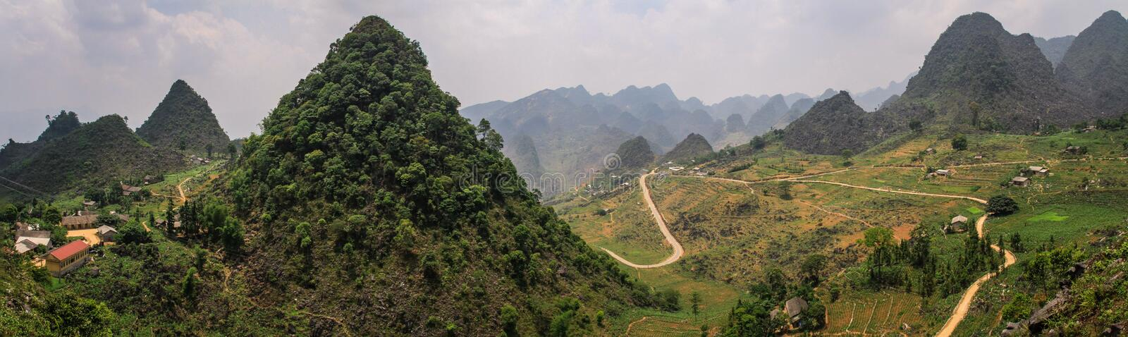 Panorama of the majestic karst mountains around Meo Vac, Ha Giang Province, Vietnam. Meo Vac is a small but charming district capital hemmed in by steep karst royalty free stock image