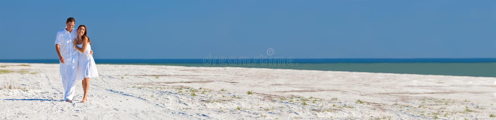 Romantic Man Woman Couple Walking on A Beach Panorama Web Banner royalty free stock images
