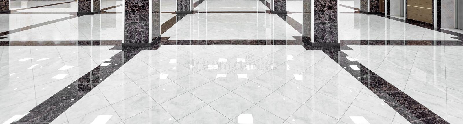 Panorama of marble floor of luxury lobby of company or hotel. Marble floor of a luxury lobby of company or hotel. Panorama of a cleaned washed floor in corporate royalty free stock photo