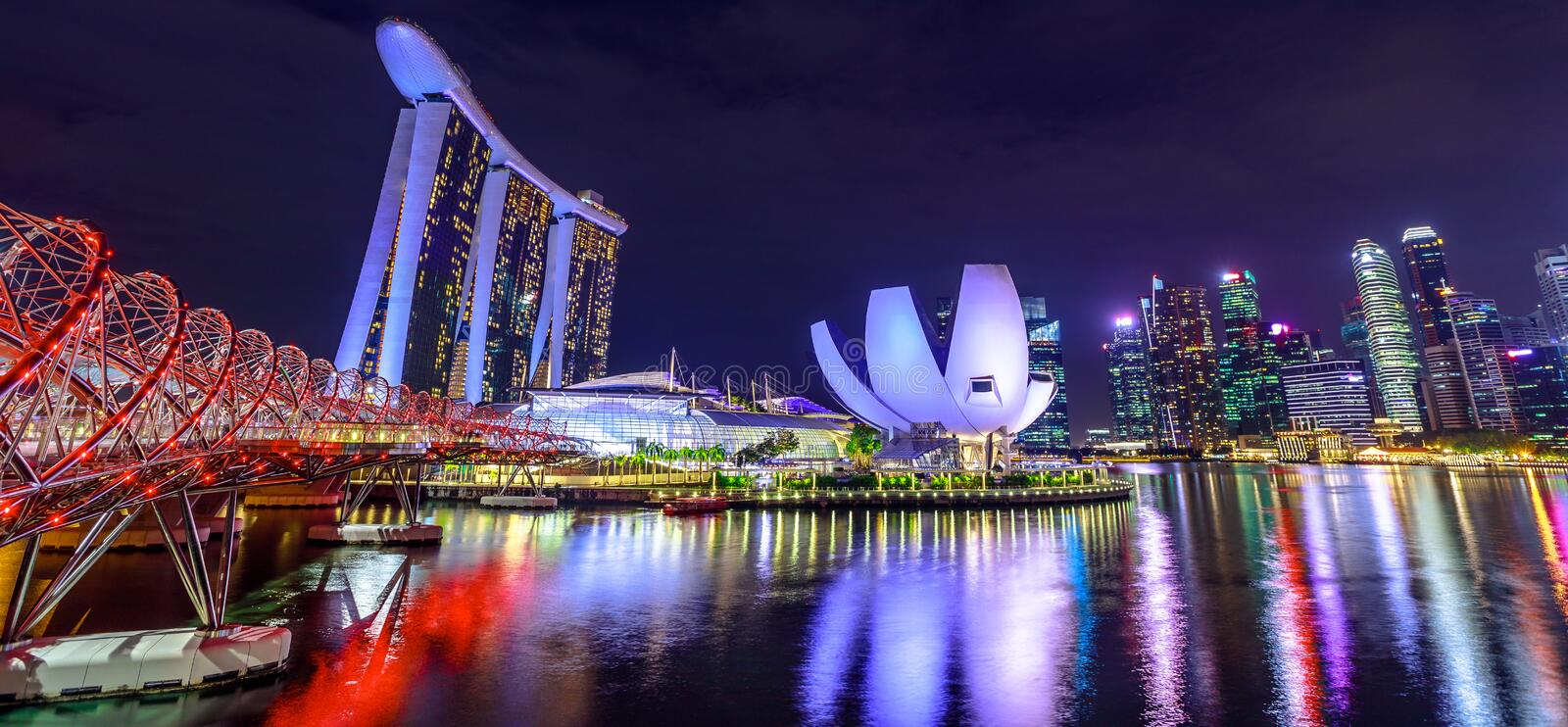 Singapore skyline night. Panorama of Marina bay buildings and skyscrapers of downtown reflected in the Harbor. Singapore architecture skyline by night. Night stock images