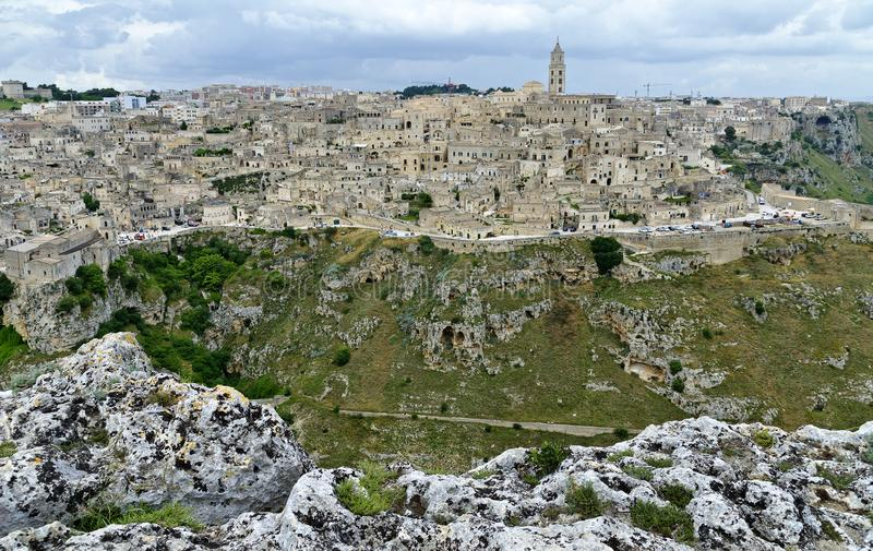 Panorama of Matera. Panoramic view across the historic town of Matera with the ravine `Gravina di Matera`, Italy stock image