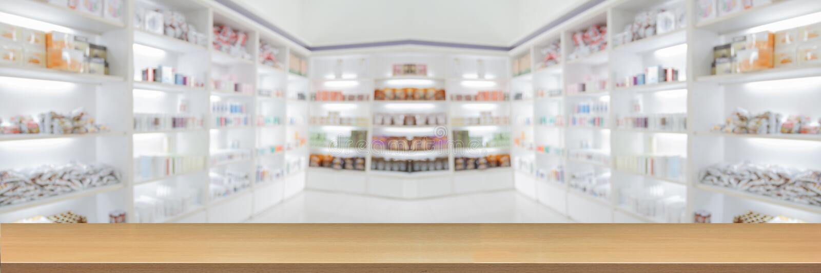 panorama on medicine cabinet and store medicine and pharmacy drugstore for Blurry background with Perspective wood royalty free stock photography