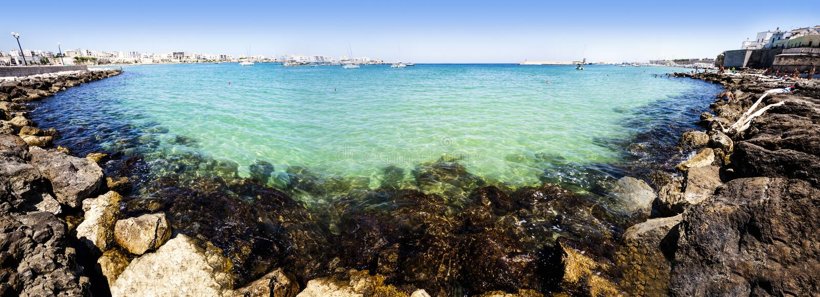 Panorama Mediterranean Sea (Ionian Sea) with rocks. Wide angle panoramic cliffs, deep blue sea and sky. City of Otranto, South Italy stock image