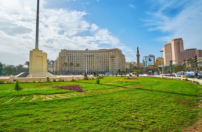 Panorama of Midan Al Tahrir, Cairo, Egypt. CAIRO, EGYPT - DECEMBER 24, 2017: Panoramic view of Midan Al Tahrir square with green lawn in the middle and royalty free stock image