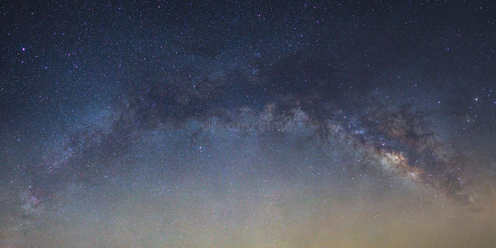 Panorama Milky way galaxy bridge as seen from thailand stock image