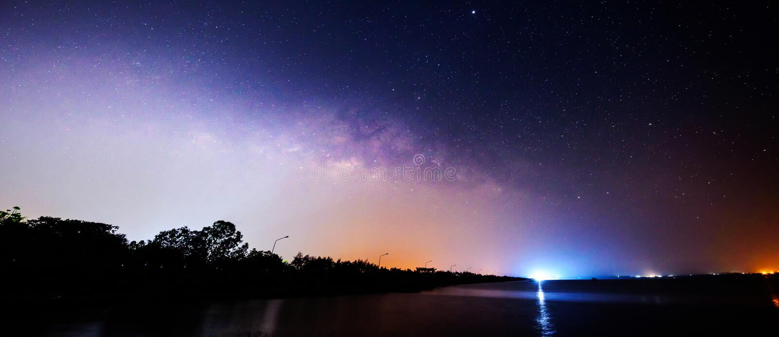 Panorama Milky way on the sky at the lake view stock photography