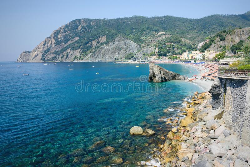 Panorama of Monterosso al Mare Beach, in season, a coastal village and resort in Cinque Terre, Liguria, Italy. Panorama of Monterosso al Mare Beach, in summer royalty free stock image