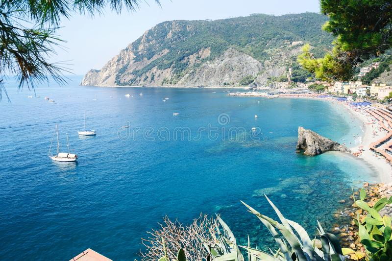Panorama of Monterosso al Mare Beach, in season, a coastal village and resort in Cinque Terre, Liguria, Italy. Panorama of Monterosso al Mare Beach, in summer royalty free stock images